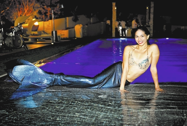 Tonya Harveny/Real Estate Millions  Dr. Eric Moskow and Regina Lynch went hired entertainers to dress up as mermaids and swim in the 4,000-square-foot pool at the guest house.