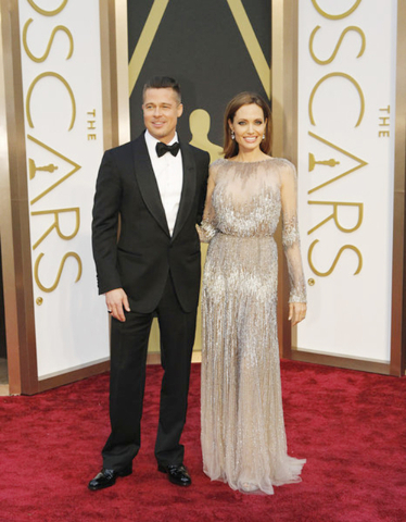 Brad Pitt and Angelina Jolie pose on the red carpet at the 2013 Academy Awards (COURTESY OF ABC)