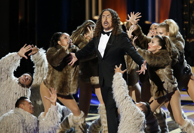 """""""Weird Al"""" Yankovic performs a medley of TV theme songs, including """"Game of Thrones,"""" during the 66th Primetime Emmy Awards in Los Angeles, California August 25, 2014. (REUTERS/Mario Anzuoni)"""