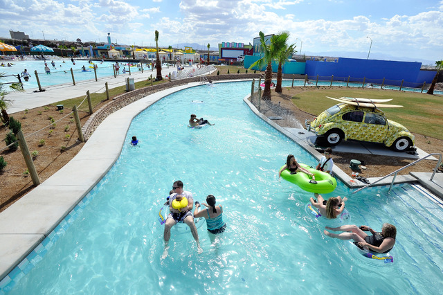 Patrons relax as they float down the lazy river during the opening day of Cowabunga Bay in Henderson on Friday, July 4, 2014. After several delays the water park opened with  25 water slides and a ...
