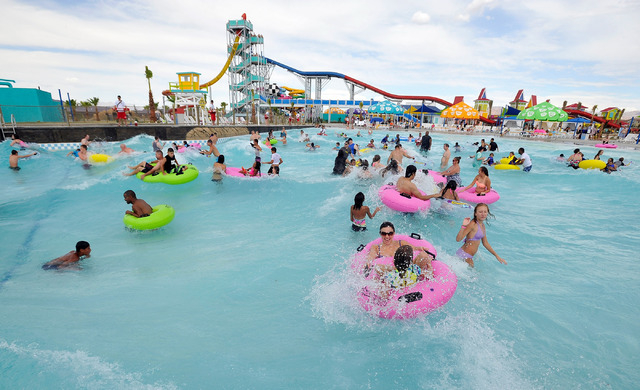 Patrons ride the swells with tubes in the wave pool during the opening day of Cowabunga Bay in Henderson on Friday, July 4, 2014. (David Becker/Las Vegas Review-Journal)