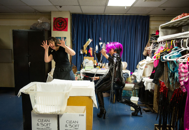 "Wardrobe supervisor Holly McKinnis, left, and ""Crazy Girls"" dancer Rachel Schiferl (cq) joke around while Schiferl (cq) waits to dance in a dominatrix costume Friday, Feb. 14, 2014 at th ..."