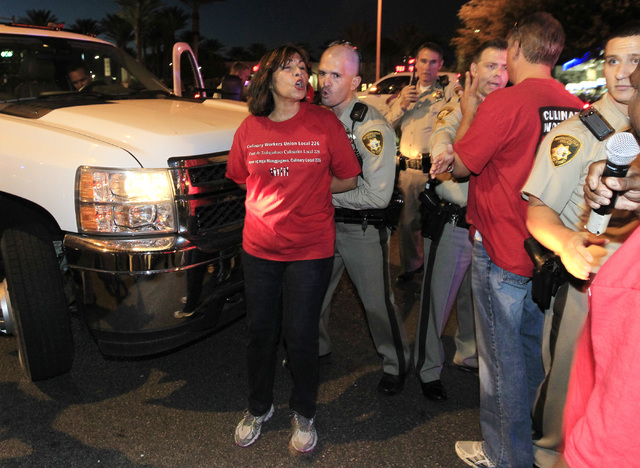 Secretary-Treasurer of Culinary Local 226 Geoconda Arguello Kline is forced away from a truck by a Metro officer during a protest outside Red Rock Resort Thursday, Oct. 9, 2014. (Sam Morris/Las Ve ...