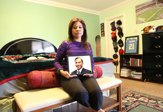 Grace Aye holds a photograph of her son William Parke in his bedroom at her Las Vegas home Wednesday, April 22, 2015. Parke was a celebrity dancer in his native Burma before moving to Las Vegas in ...
