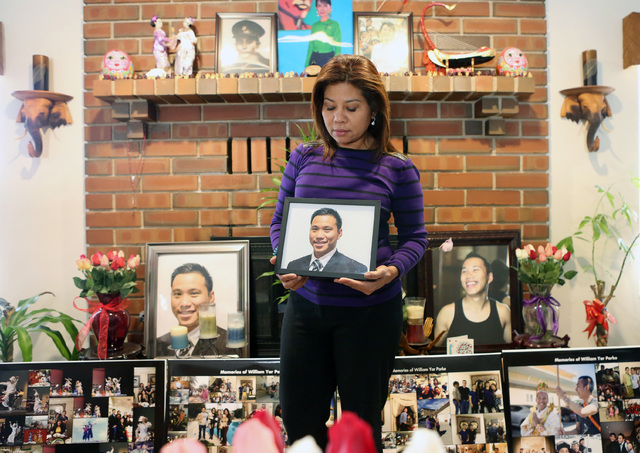 Grace Aye holds a photograph of her son, William Parke, at her house in Las Vegas, Wednesday, April 22, 2015. Parke was a celebrity dancer in his native Burma before moving to Las Vegas in 2005. P ...