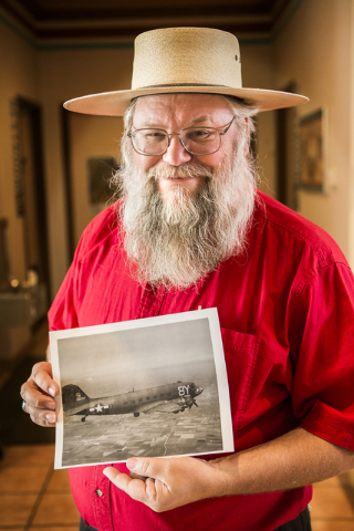 Mark Hall-Patton, administrator of Clark County Museum, 1830 S. Boulder Highway, in Henderson, holds a photo on Thursday, May 7, 2015, of the C-47 transport plane that 1st Lt. Howard Cannon co-pil ...