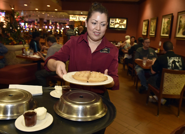 Server Ledna Martinez delivers a freshly made waffle to customers at Cafe Cortez in the El Cortez May 4, 2015. (David Becker/View) (Click for more photos)