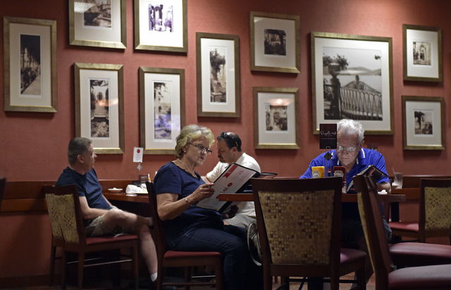 Restaurant patrons review menu items as they sit inside Cafe Cortez restaurant in the El Cortez May 4, 2015. (David Becker/View)