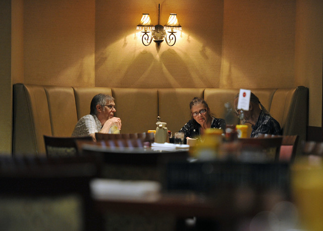 Restaurant patrons sit in a booth at Cafe Cortez at the El Cortez May 4, 2015. (David Becker/View)