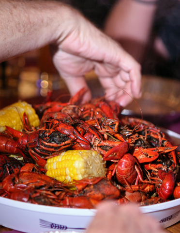 Guests dig into a tray filled with 5 pounds of steamed crawfish at Lola's Summerlin location May 1, 2015. (Ronda Churchill/View)