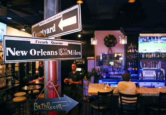 Signs are shown at the restaurant entrance near the bar at the Summerlin location of Lola's A Louisiana Kitchen, 1220 N. Town Center Drive, May 1, 2015. The Louisiana kitchen serves an array of au ...