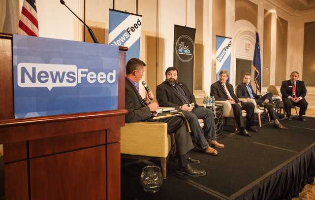 Glenn Cook, left, senior editorial  for the Las Vegas Review-Journal, moderates a Newsfeed panel discussion on unmanned aerial vehicles at the Four Seasons Hotel on Wednesday, May 13, 2015. Also p ...