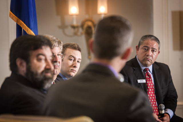 Glenn Cook, back to camera, senior editorial writer for the Las Vegas Review-Journal, moderates a Newsfeed panel discussion on unmanned aerial vehicles at the Four Seasons on Wednesday, May 13, 20 ...