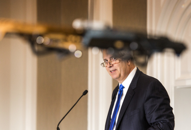 Bob Brown, board chairman for Las Vegas Metro Chamber Commerce, watches a unmanned aerial vehicle demonstration during Newsfeed at the Four Seasons, 3960 Las Vegas Boulevard, on Wednesday, May 13, ...