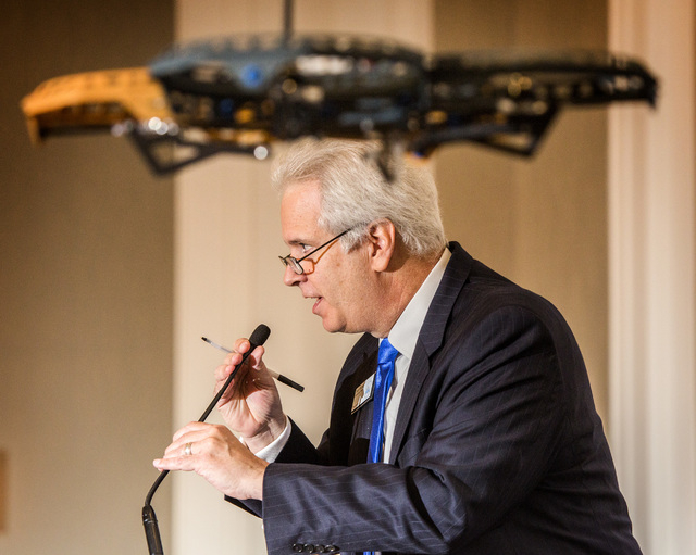 Bob Brown, board chairman for Las Vegas Metro Chamber Commerce, speaks during an unmanned aerial vehicle demonstration during Newsfeed at the Four Seasons on Wednesday, May 13, 2015. The drone is  ...