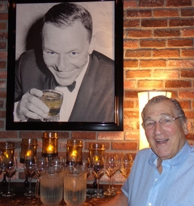 Vegas comedy legend Shecky Greene with a photo of Frank Sinatra at the Italian American Club on Sunday. (Norm Clarke/Las Vegas Review-Journal)