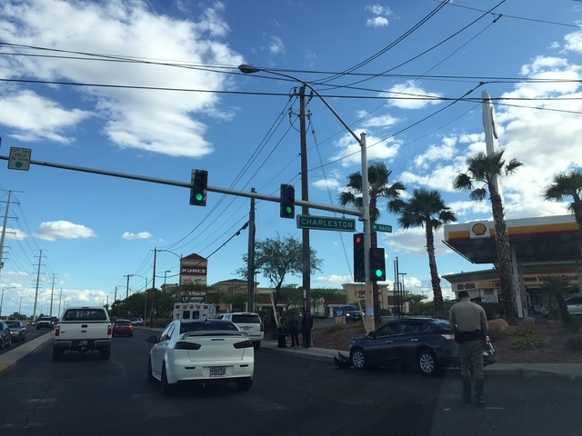 Two juveniles were hospitalized with nonlife-threatening injuries after a three-car crash at Charleston Boulevard and Durango Drive on Saturday afternoon, May 23, 2015. (Stephanie Grimes/Reviewjou ...