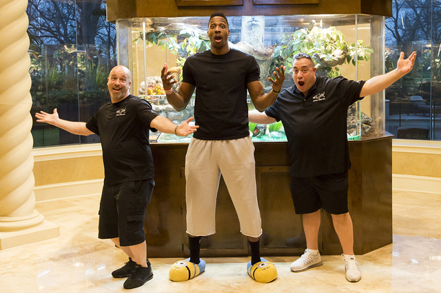 """From left, Brett Raymer, Dwight Howard and Wayde King appear in a scene from Animal Planet's """"Tanked."""" (Courtesy photo)"""