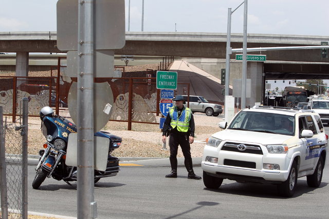 A Nevada Highway Patrol trooper closes the Martin Luther King Boulevard on-ramp to southbound Interstate 15 on Friday, May 22, 2015. A 4.8-magnitude earthquake shook Las Vegas and surrounding area ...