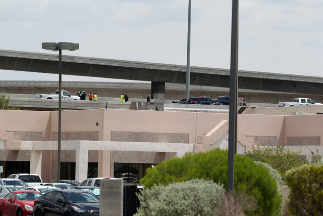 Officials from the Nevada Department of Transportation and Nevada Highway Patrol troopers investigate possible damage on the ramp from southbound U.S. Route 95 to southbound Interstate 15 on Frida ...
