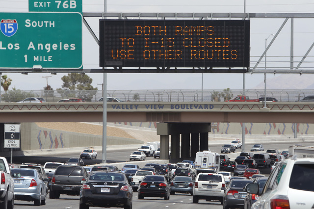 Electronic highway signs displays the closure of both I-15 ramps, as officials from the Nevada Department of Transportation and Nevada Highway Patrol investigate possible damage on the ramp from s ...