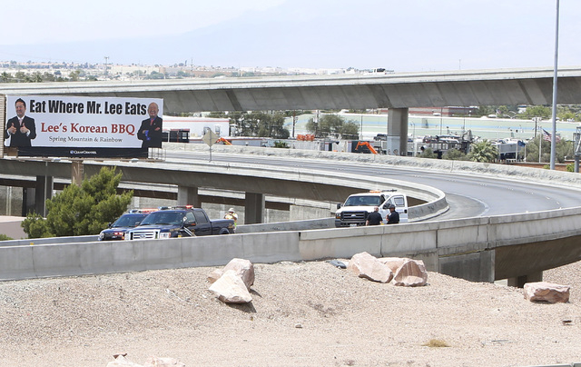 Officials from the Nevada Department of Transportation and Nevada Highway Patrol investigate possible damage on the ramp from southbound U.S. Route 95 to southbound Interstate 15 on Friday, May 22 ...