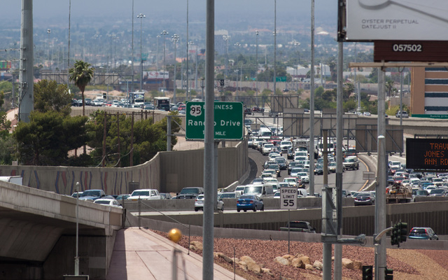 Traffic going southbound on U.S. Route 95 is seen backed up as officials from the Nevada Department of Transportation and Nevada Highway Patrol investigate possible damage on the ramp from southbo ...