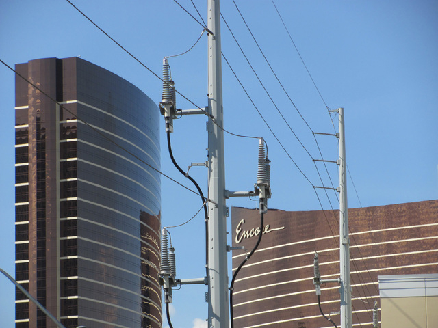 The Encore tower is shown under power lines that run along Koval Lane in this Sunday, April 19, 2015, photo. The Wynn tower is at left. (Greg Haas/Las Vegas Review-Journal)