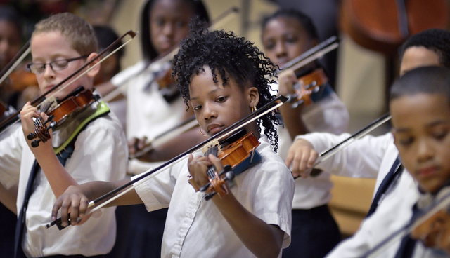 Rainbow Dreams Academy fifth-grader Jah Zararegan, center, performs during a recital April 11 at the Historic Fifth Street School, 401 S. 4th St. (Bill Hughes/View)