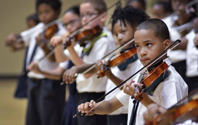 Rainbow Dreams Academy fourth-grader Chris Tyler, right, plays violin during a recital at the Historic Fifth Street School. (Bill Hughes/View)