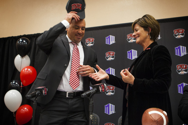 UNLV athletic director Tina Kunzer-Murphy, right, introduces Tony Sanchez as UNLV's men's football coach, Thursday, Dec. 11,2014, at Stan Fulton Building.  Sanchez, former Bishop Gorman High Schoo ...