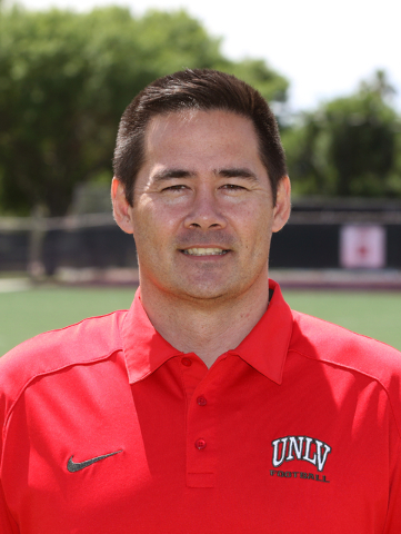 Jimmy Morimoto, director of player personnel and assistant recruiting coordinator for UNLV football, stands on the UNLV football practice field Friday, May 15, 2015, in Las Vegas. Morimoto, who is ...