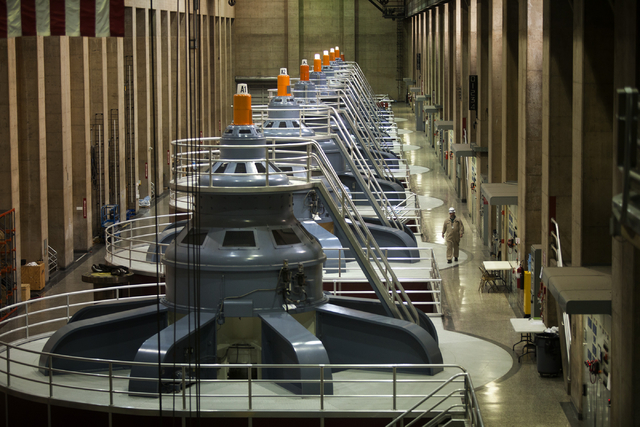 The turbine room inside Hoover Dam as seen Thursday, March 20, 2014 at Hoover Dam.  Projections from the U.S. Bureau of Reclamation indicate Lake Mead could fall low enough next year to reduce pow ...