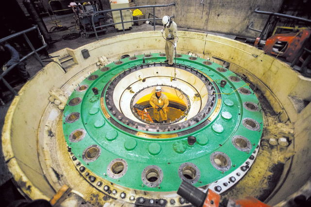 Kevin Zito, top, hands  David Polan a grinder while then prep for a turbine installation at Hoover Dam on Thursday, March 20, 2014. Projections from the U.S. Bureau of Reclamation indicate Lake Me ...