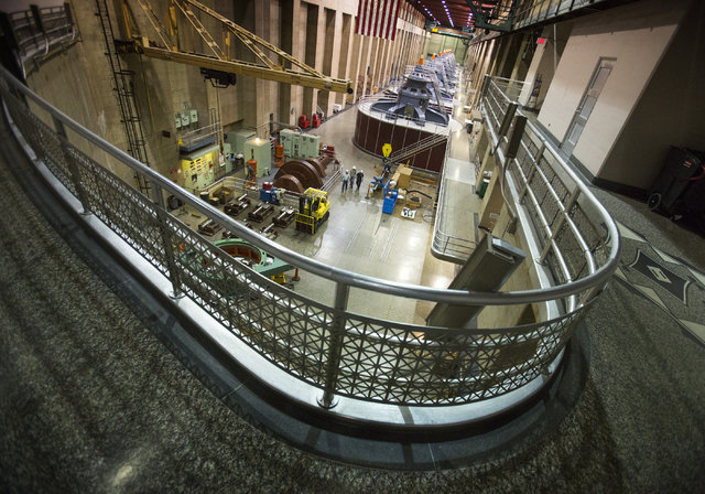 The turbine room inside Hoover Dam as seen Thursday, March 20, 2014 at Hoover Dam. Projections from the U.S. Bureau of Reclamation indicate Lake Mead could fall low enough next year to reduce powe ...