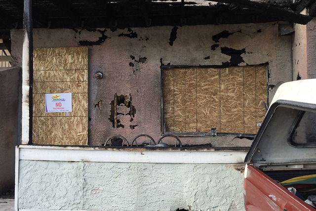 A boarded-up residence in the 6900 block of Hopkins Drive, Clark County, where police say Zayquan Jones set fire to a blanket on top of a stove. The fire displaced the other three residents in the ...