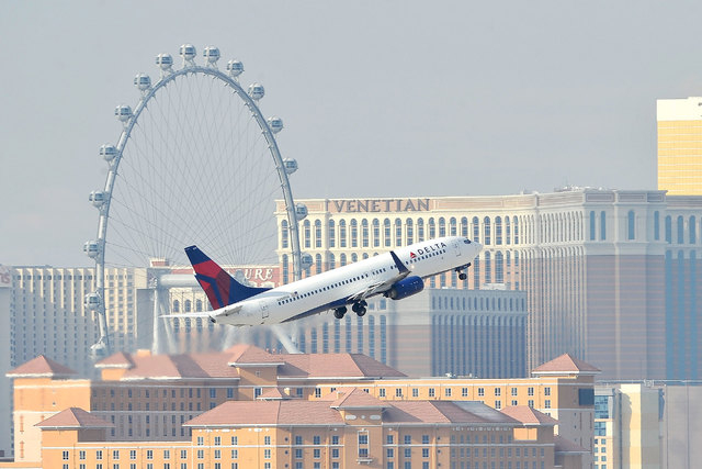 A Delta Air Lines flight passes by the Strip after taking off from McCarran International Airport. (David Becker/Las Vegas Review-Journal file)