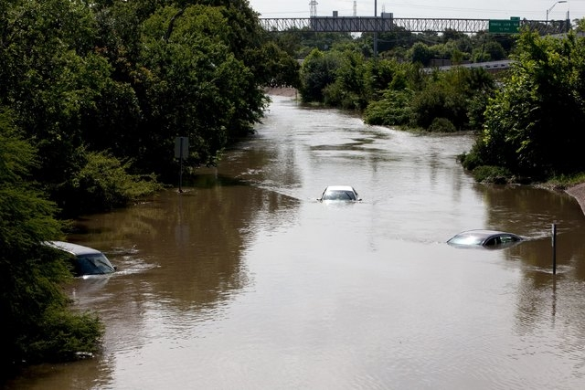 Flood waters cover several cars on the South I-610 frontage road in Houston, Texas May 26, 2015. Torrential rains have killed at least eight people in Texas and Oklahoma, including two in Houston  ...
