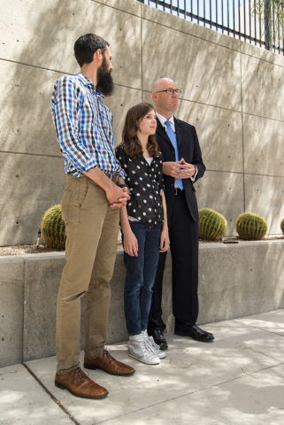 Mackenzie Fraiser, a sixth-grader at Somerset Academy, her father Tim Fraiser, left, and Jeremy Dys, senior counsel for religious rights law firm Liberty Institute, speak with reporters at a news  ...