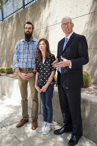 Mackenzie Fraiser, a sixth-grader at Somerset Academy, her father, Tim Fraiser, left, and Jeremy Dys, senior counsel for religious rights law firm Liberty Institute, speak with reporters at a news ...