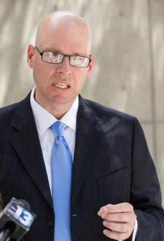 Jeremy Dys, senior counsel for religious rights law firm Liberty Institute, speaks with reporters at a news conference on the sidewalk in front of the Lloyd George U.S. Courthouse on Wednesday, Ma ...