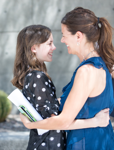 Mackenzie Fraiser, a sixth-grader at Somerset Academy, gets a hug from her stepmother, Kate Fraiser, after a news conference on the sidewalk in front of the Lloyd George U.S. Courthouse on Wednesd ...