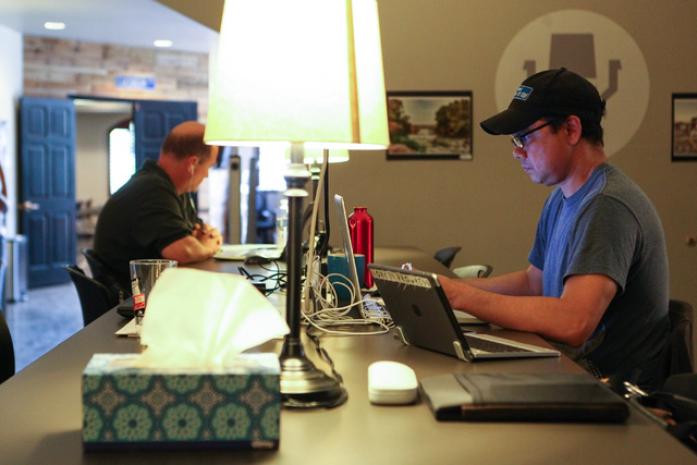 People, including Quint Rahaman, right, work in open office spaces at Work in Progress, 317 6th St., in downtown Las Vegas on Tuesday, May 5, 2015. Work in Progress offers work stations and and st ...