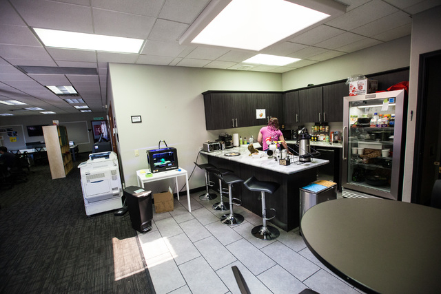 The kitchen area is seen next to open office spaces at Work in Progress, 317 6th St., in downtown Las Vegas on Tuesday, May 5, 2015. Work in Progress offers work stations and and startup services  ...