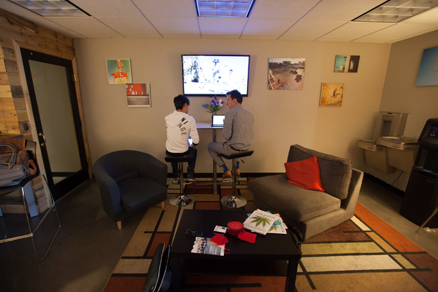 Alex Gao, left, and Jay Romo work in open office spaces at Work in Progress, 317 6th St., in downtown Las Vegas on Tuesday, May 5, 2015. Work in Progress offers work stations and and startup servi ...