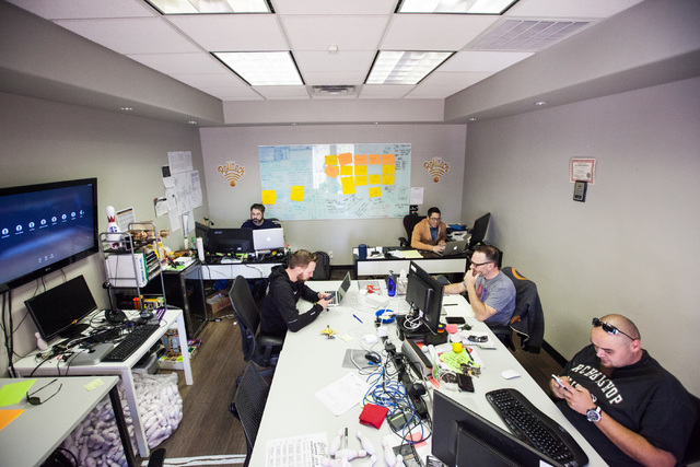 Members of startup Rolltech work in their room at Work in Progress, 317 6th St., in downtown Las Vegas on Tuesday, May 5, 2015. Work in Progress offers work stations and and startup services for i ...