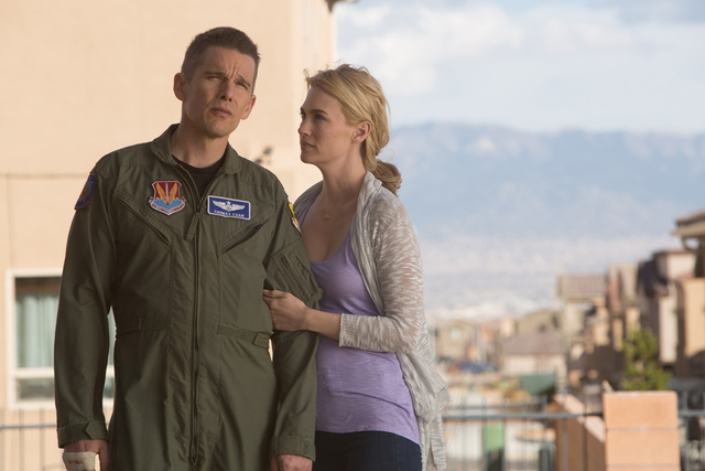 Ethan Hawke (Tom Egan) and January Jones (Molly Egan) in Andrew Niccol's GOOD KILL.  Courtesy of Lorey Sebastian.  (C) 2014 Clear Skies Nevada LLC. An IFC Films release.