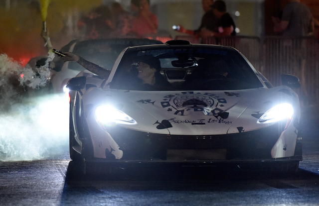 Participants arrive at the end of the 17th annual Gumball 3000 rally at the MGM Resorts Village on Friday, May 29, 2015. One hundred vehicles participated in a seven-day, transcontinental driving  ...