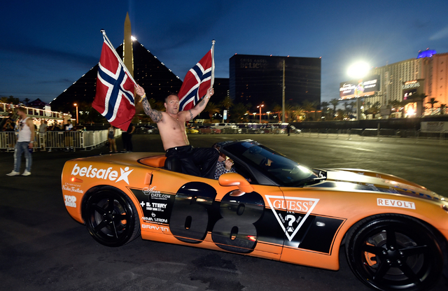 Flags of Norway are flown as a participant arrives at the end of the 17th annual Gumball 3000 rally at the MGM Resorts Village on Friday, May 29, 2015. One hundred vehicles participated in a seven ...