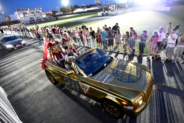 Vehicles arrive at the end of the 17th annual Gumball 3000 rally at the MGM Resorts Village on Friday, May 29, 2015. One hundred vehicles participated in a seven-day, transcontinental driving tour ...